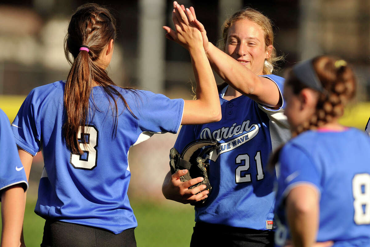 Darien's Lexi LoPiano, left, congratulates her team mate Erika Osherow, who pitched a complete game against Greenwich at Greenwich High School in Greenwich, Conn., on Monday, May 5, 2014. Darien defeated Greenwich, 6-0.