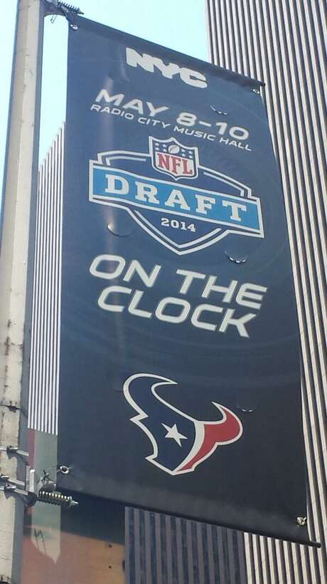 Because they own the first selection in Thursday's NFL draft, the Texans have the most prominent team banner on New York's Avenue of the Americas. Photo: John McClain / ONLINE_YES