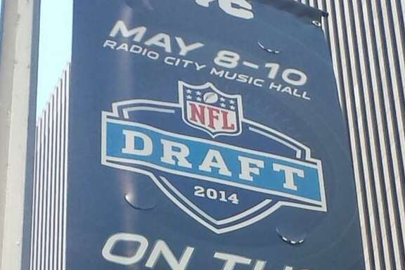 Because they own the first selection in Thursday's NFL draft, the Texans have the most prominent team banner on New York's Avenue of the Americas.