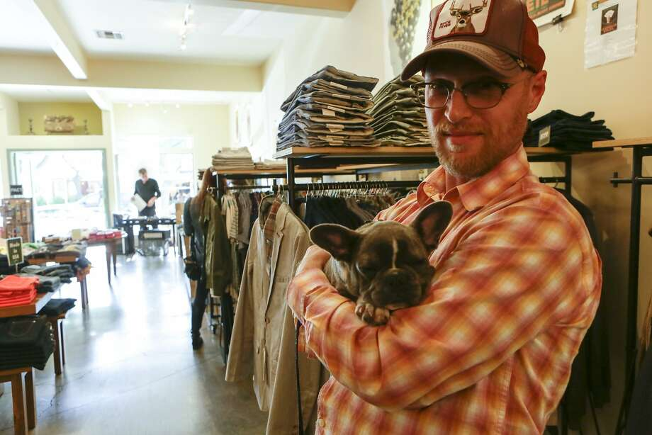 Randall Baxter shops with French bulldog puppy Kali at Convert in Berkeley. Photo: Yoni Mayeri, Special To The Chronicle