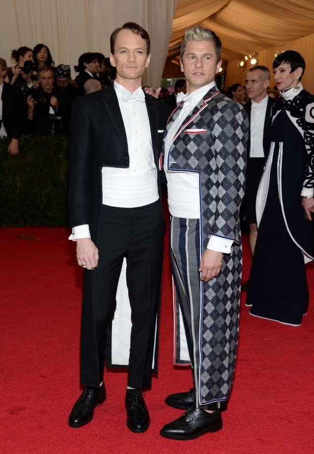 "Neil Patrick Harris, left, and David Burtka attend The Metropolitan Museum of Art's Costume Institute benefit gala celebrating ""Charles James: Beyond Fashion"" on Monday, May 5, 2014, in New York. Photo: Evan Agostini, Associated Press"