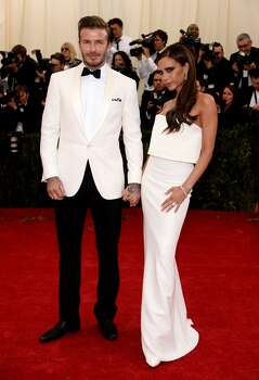 "David Beckham and Victoria Beckham attend the ""Charles James: Beyond Fashion"" Costume Institute Gala at the Metropolitan Museum of Art on May 5, 2014 in New York City. Photo: Dimitrios Kambouris, Getty Images"