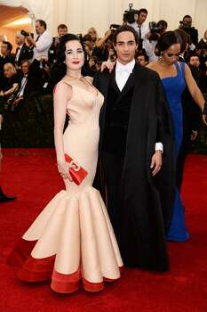 "Dita Von Teese (L) and designer Zac Posen attend the ""Charles James: Beyond Fashion"" Costume Institute Gala at the Metropolitan Museum of Art on May 5, 2014 in New York City. Photo: Dimitrios Kambouris, Getty Images"