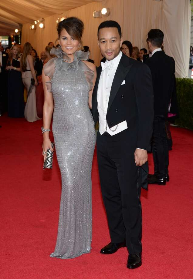 "Chrissy Teigen, left, and John Legend attend The Metropolitan Museum of Art's Costume Institute benefit gala celebrating ""Charles James: Beyond Fashion"" on Monday, May 5, 2014, in New York. Photo: Evan Agostini, Associated Press"