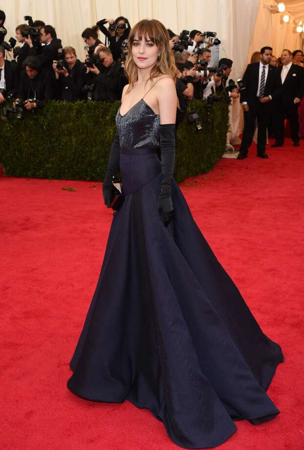"""Model Dakota Johnson attends the """"Charles James: Beyond Fashion"""" Costume Institute Gala at the Metropolitan Museum of Art on May 5, 2014 in New York City. Photo: Larry Busacca, Getty Images"""