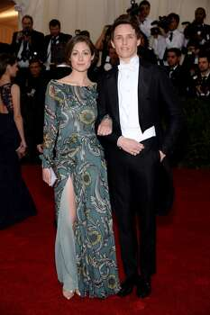 "Eddie Redmayne (R) and Hannah Bagshawe attend the ""Charles James: Beyond Fashion"" Costume Institute Gala at the Metropolitan Museum of Art on May 5, 2014 in New York City. Photo: Dimitrios Kambouris, Getty Images"
