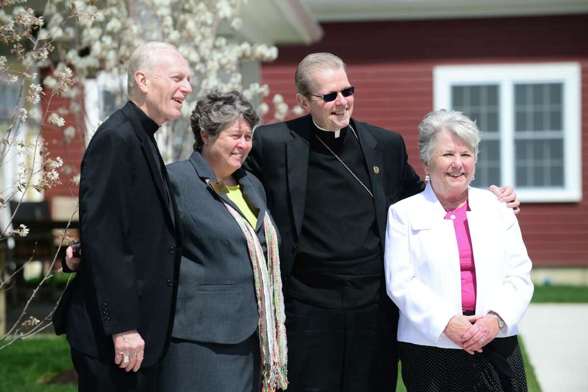 Bishop Emeritus Howard Hubbard, left, Kay Ryan, executive team member for Shaker Pointe, Albany Bishop Edward Scharfenberger and Lauren Van Dermark, executive team member for Shaker Pointe, right, pose for a photo following ceremonies which marked the grand opening of Shaker Pointe at Carondelet, a non-profit independent living community, Monday, May, 5, 2014, in Colonie, N.Y. (Will Waldron/Times Union)