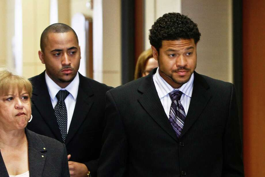Robbie Tolan, right, was in court in 2010 at the aggravated assault trial of Bellaire police Sgt. Jeff Cotton, who was accused of shooting Tolan in his parents' driveway in 2008. He was found not guilty. The high court Monday ordered the 5th U.S. Circuit Court of Appeals to revisit the civil case. Photo: Michael Paulsen, Staff / Houston Chronicle