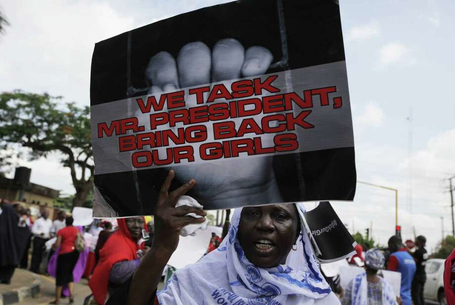 A woman attends a demonstration in Lagos urging President Goodluck Jonathan to find hundreds of female students taken from a Nigerian school nearly three weeks ago. Photo: Associated Press / AP