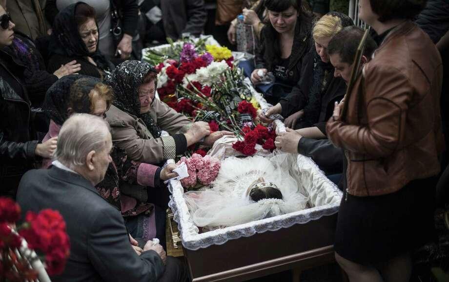 Yulia Izotova, 21, is mourned in Kramatorsk, Ukraine. Witnesses said she was shot by a Ukrainian military column on a road. Photo: Manu Brabo / Associated Press / AP