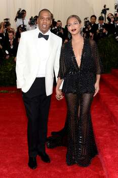 "Here's a look at Jay-Z and Beyonce, as they attend the ""Charles James: Beyond Fashion"" Costume Institute Gala at the Metropolitan Museum of Art on May 5, 2014 in New York City. This is the same night as the infamous fight with Solange. Take a look to see who else was at the event. Photo: Dimitrios Kambouris, Getty Images"