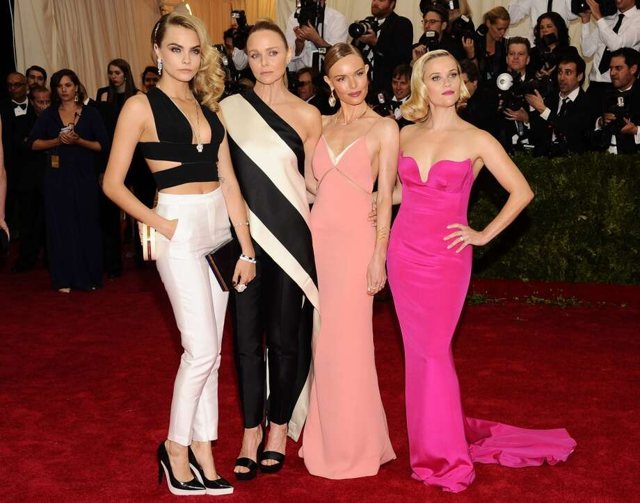 "Cara Delevingne, from left, Stella McCartney, Kate Bosworth, and Reese Witherspoon attend The Metropolitan Museum of Art's Costume Institute benefit gala celebrating ""Charles James: Beyond Fashion"" on Monday, May 5, 2014, in New York. Photo: Charles Sykes, Associated Press"