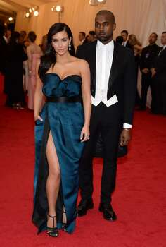 "Kim Kardashian, left, and Kanye West attend The Metropolitan Museum of Art's Costume Institute benefit gala celebrating ""Charles James: Beyond Fashion"" on Monday, May 5, 2014, in New York. Photo: Evan Agostini, Associated Press"