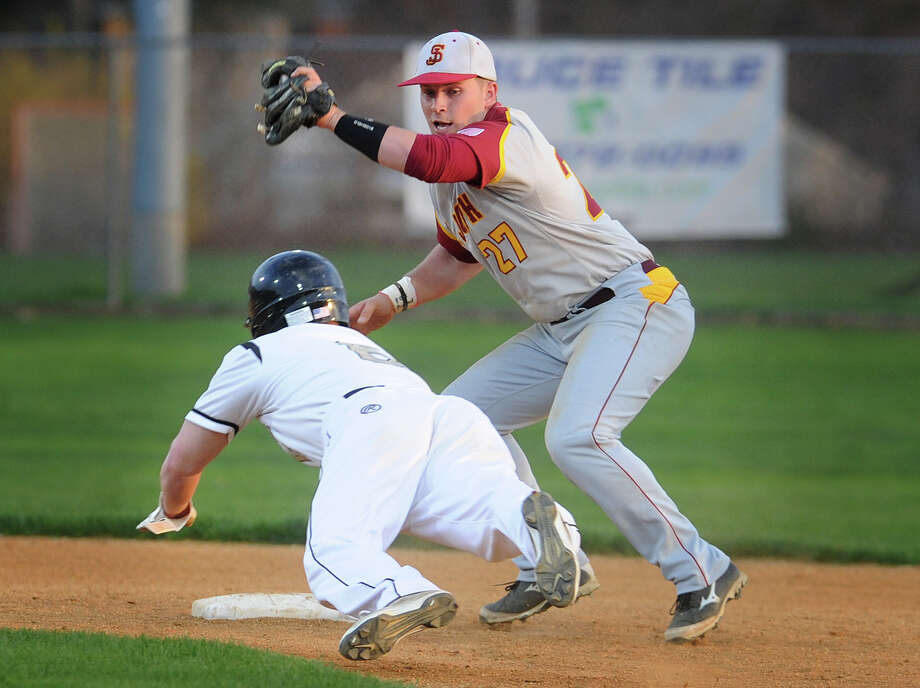 St. Joseph shortstop Mark Hirschbeck puts the tag on Trumbull base stealer Chris Masi in the second inning of their FCIAC baseball matchup at Trumbull High School in Trumbull, Conn. on Monday, May 5, 2014. Photo: Brian A. Pounds / Connecticut Post