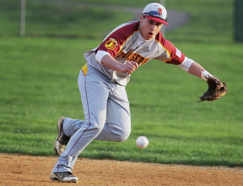 St. Joseph second baseman Dave Capela tries to get to a ground ball base hit in the first inning of their FCIAC baseball matchup with rival Trumbull at Trumbull High School in Trumbull, Conn. on Monday, May 5, 2014. Photo: Brian A. Pounds / Connecticut Post