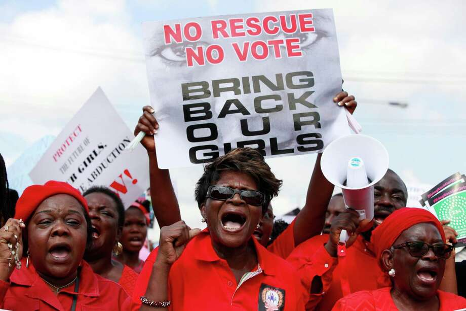 Protesters call on the Nigerian government to rescue the 276 kidnapped schoolgirls. The Islamist group Boko Haram on Monday claimed credit for the abductions. Photo: Sunday Alamba, STF / AP