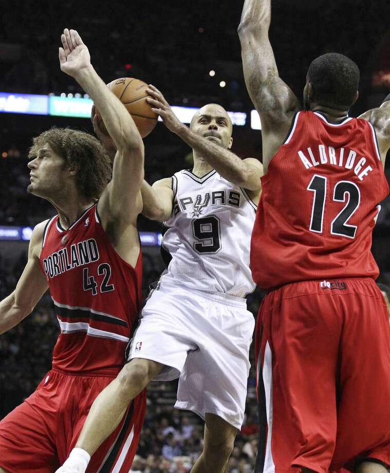 Tony Parker and the Spurs split the season 2-2 vs. Robin Lopez (42), LaMarcus Aldridge and Portland. Photo: Kin Man Hui / San Antonio Express-News / ©2013 San Antonio Express-News