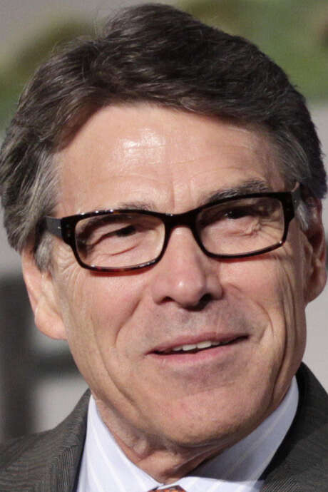 Gov. Rick Perry and sheriffs say total compliance would be too costly and in some cases impossible. / AP
