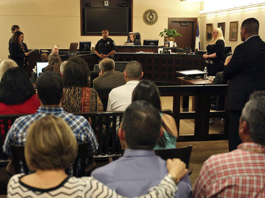 """Cedrych """"Yanni"""" Carrisalez's sister, Calysta Carrisalez (left), reads a victim impact statement to Amy Humphreys (right) in the 175th District Court. Humphreys was sentenced to 15 years in prison for intoxication manslaughter. Photo: Photos By Edward A. Ornelas / San Antonio Express-News / © 2014 San Antonio Express-News"""