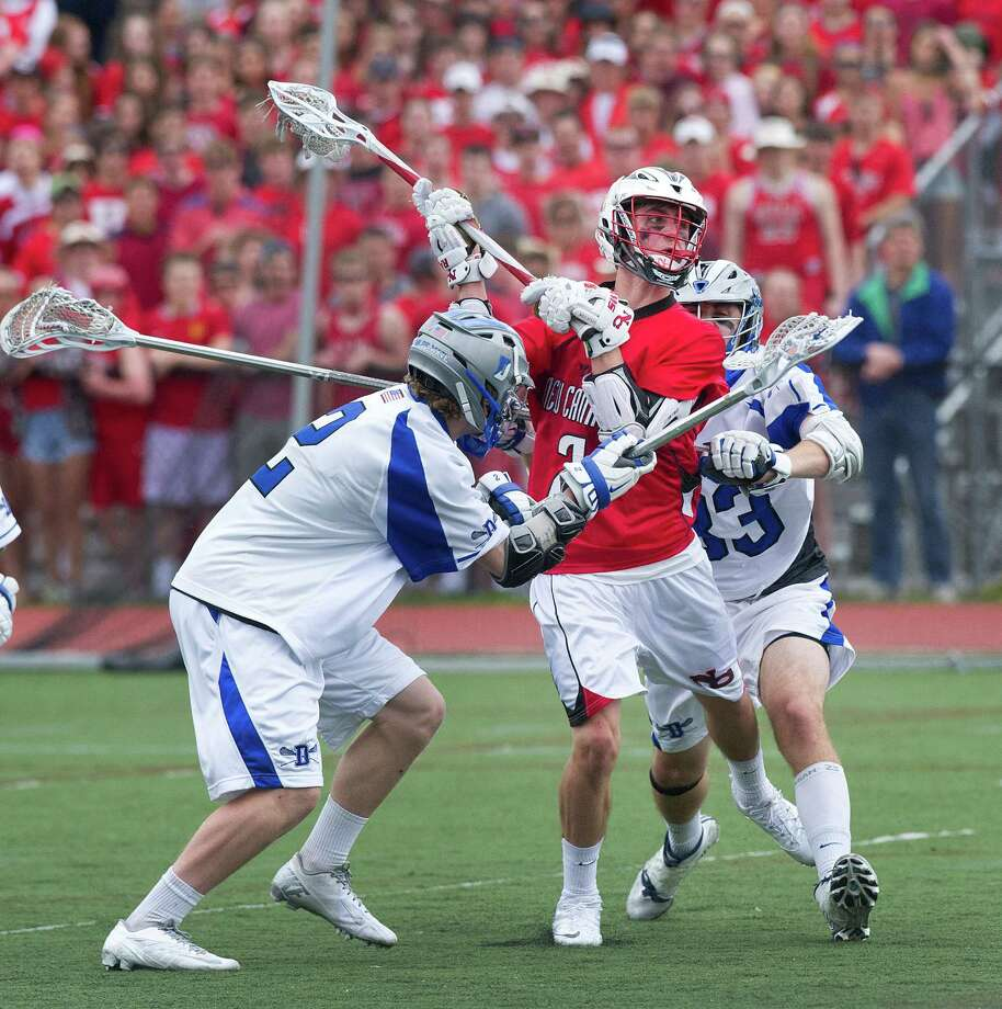 New Canaan's Justin Meichner scores a goal during Saturday's boys lacrosse game in Darien, Conn., on May 3, 2014. Photo: Lindsay Perry / Stamford Advocate