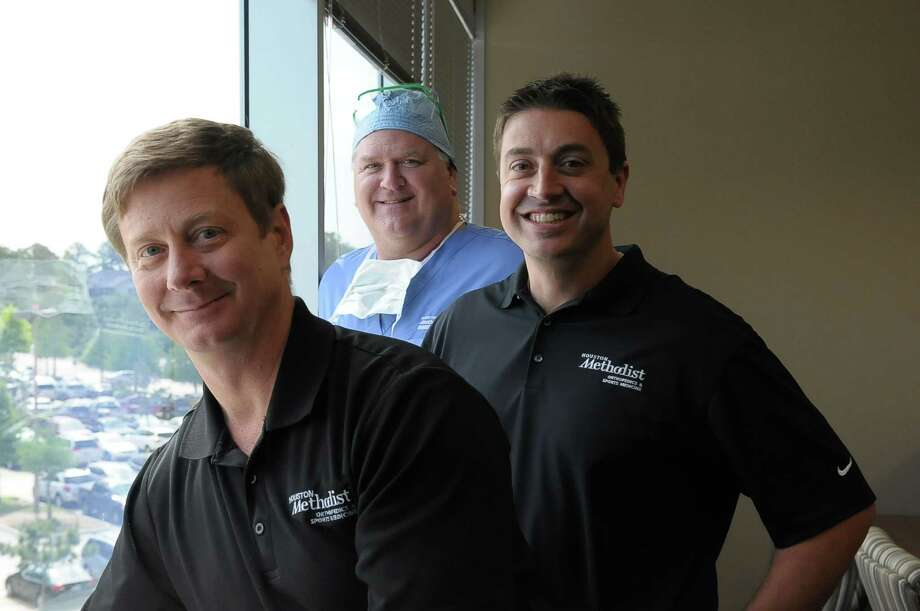 Dr. Scott Rand, left, Dr. Bruce Moseley and Dr. Christian Schupp, right, colleagues at Houston Methodist Willowbrook Hospital's Center for Orthopaedic Surgery and Sports Medicine, work with Klein ISD's four high schools. Photo: Â Tony Bullard 2014, Freelance Photographer / © Tony Bullard & the Houston Chronicle