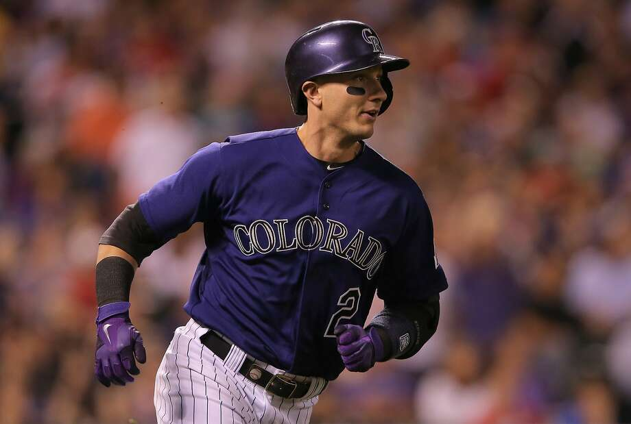 Colorado's Troy Tulowitzki hit two home runs and has multihit outings in six of his past seven games. Photo: Doug Pensinger, Getty Images