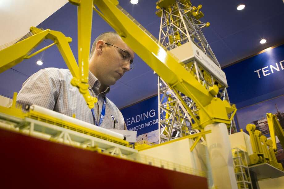 Matt Sanders of Houston takes a looks at the Bassoe Technology BT-UDS Ultra Deepwater Drillship miniature parts that he works with in real size as part of his job. Monday, May 5, 2014, in Houston. ( Marie D. De Jesus / Houston Chronicle ) Photo: Marie D. De Jesus, Houston Chronicle