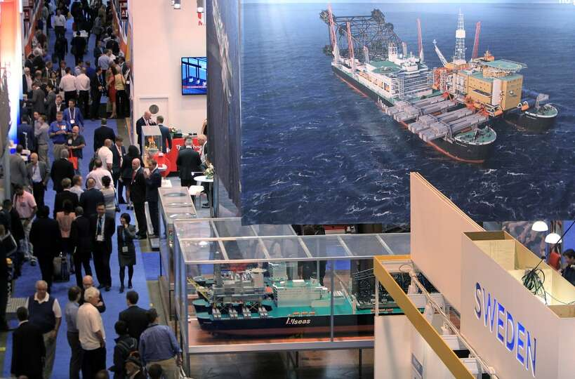 Crowds walk their way through the exhibition floor of the 2014 Offshore Technology Conference at NRG