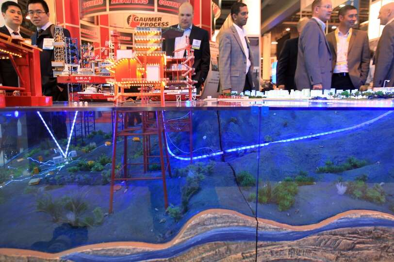 Sinopec Oilfield Service Corporation exhibition booth displays an underwater view of an offshore pla