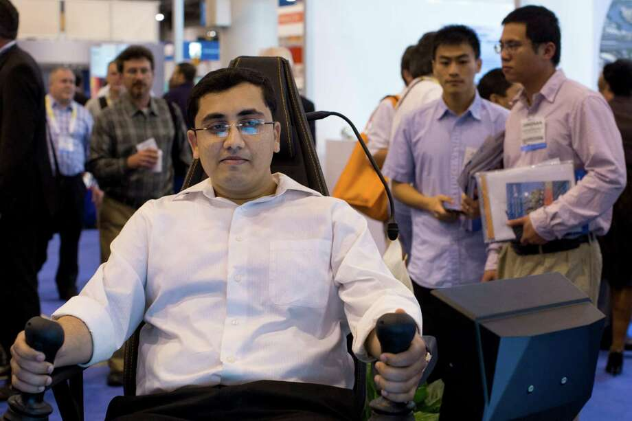 Priyank Mehta tests the Aker Solutions operations control  chair. Photo: Marie D. De Jesus, Staff / © 2014 Houston Chronicle