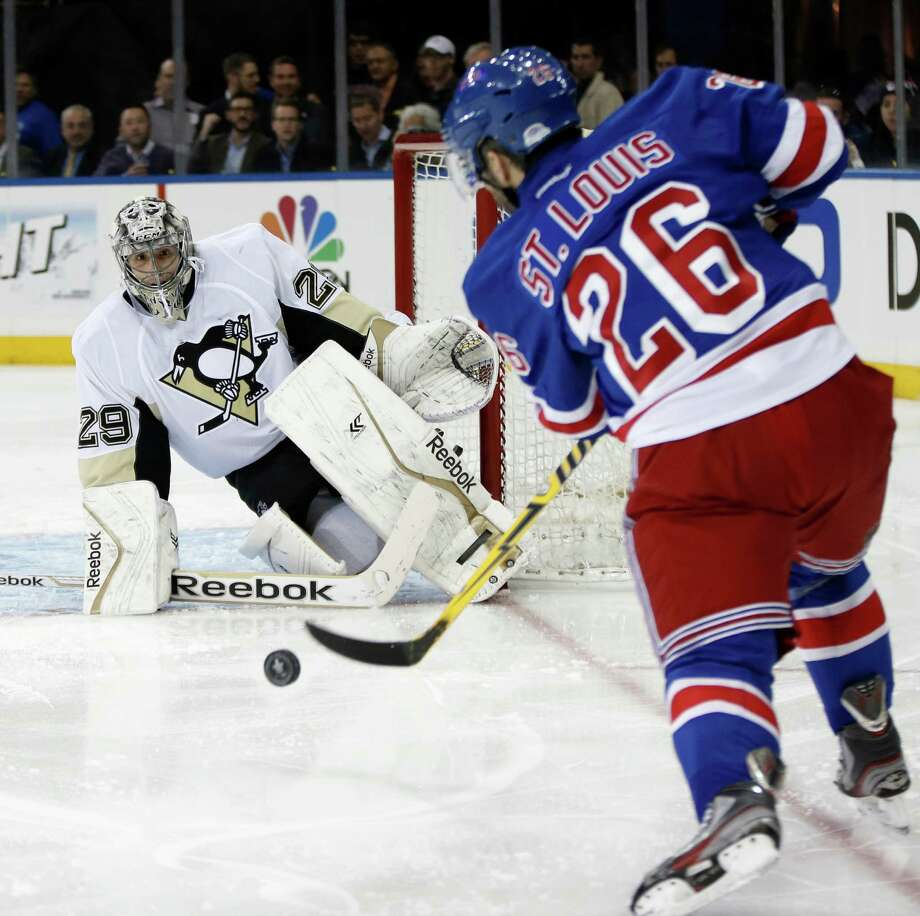 Penguins goalie Marc-Andre Fleury (29) stopped 35 shots in a 2-0 victory over the Rangers, including this second-period effort by Martin St. Louis (26). Photo: Kathy Willens, STF / AP