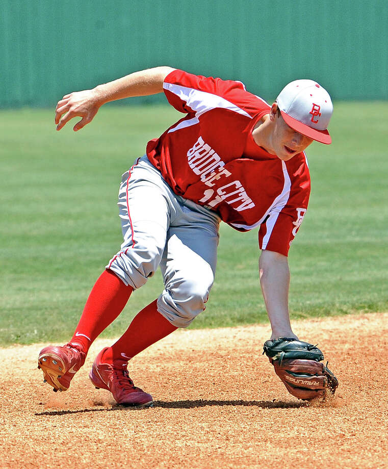 Bridge City shortstop Blaine McElduff, #11, fields a ground ball during the Bridge City playoff baseball game against Huffman-Hargrave on Saturday, May18, 2013, in La Porte.
