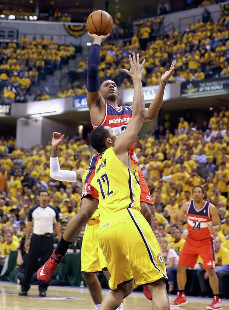 Washington's Bradley Beal goes up for two of his 25 points against Indianapolis' Evan Turner on Monday night. Photo: Andy Lyons, Staff / 2014 Getty Images