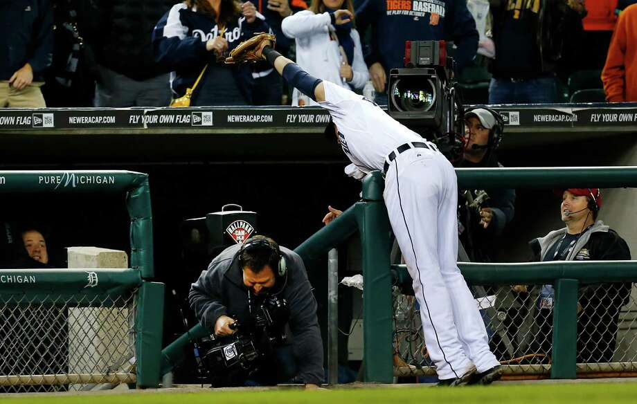 Tigers third baseman Nick Castellanos extends himself to make sure the game ends on Chris Carter's foul ball in the ninth. Photo: Paul Sancya, STF / AP