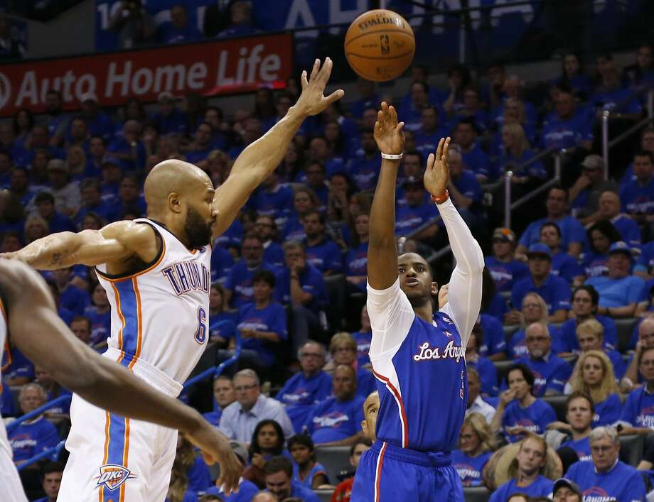 Clippers guard Chris Paul (right) had a career-high eight three-pointers in Game 1 against the Thunder. Photo: Sue Ogrocki, Associated Press