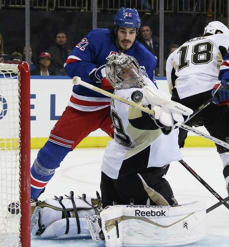 Penguins goalie Marc-Andre Fleury makes a save as the Rangers' Brian Boyle looks for a rebound. Photo: Bruce Bennett / Getty Images / 2014 Getty Images