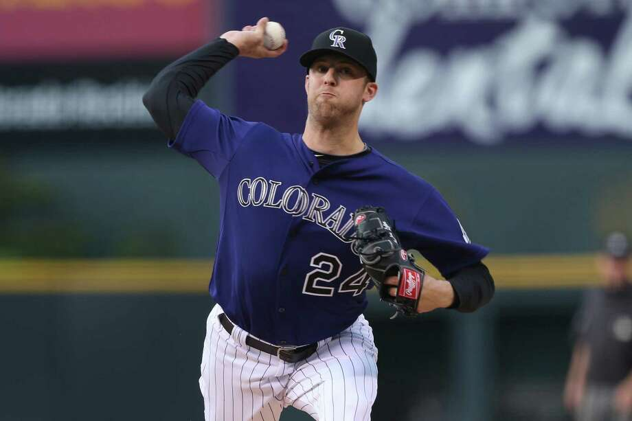 Rockies pitcher Jordan Lyles (4-0), an ex-Astro, allowed two runs on seven hits with five strikeouts. Photo: David Zalubowski / Associated Press / AP