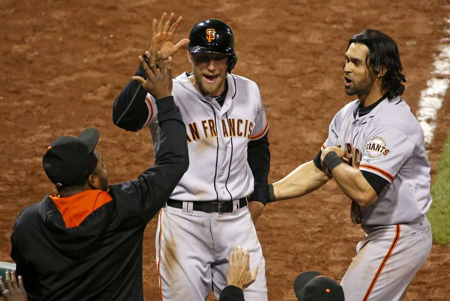 Hunter Pence receives a high-five after scoring the go-ahead run in the 13th. Photo: Gene J. Puskar, Associated Press