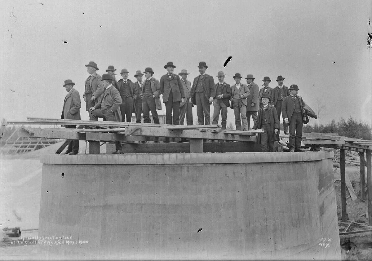 Volunteer Park - Capitol Hill - Workers and city officials examine the Volunteer Park reservoir in 1900, pictured in a Seattle Municipal Archive photo.