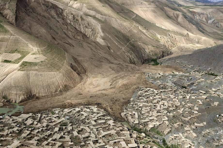 Mountain moved:An aerial view shows the breadth of the disaster after a landslide buried part of the town of Abi   Barik in Badakhshan province, northeastern Afghanistan. More than 2,000 people are   believed to have been killed. Photo: Rahmat Gul, Associated Press