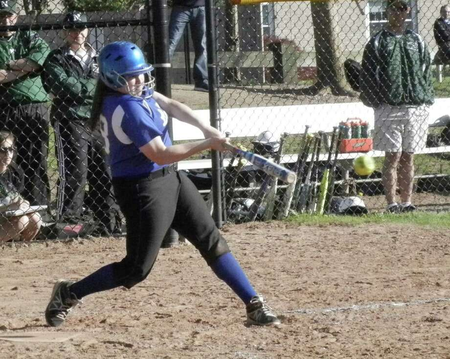 Fairfield Ludlowe third baseman Brenna Martini smacks a single into left field in the Falcons' two-run fifth inning at Sturges Park on Monday, May 5 in an FCIAC softball game against Norwalk. Martini went 3-for-3 in Ludlowe's 8-4 win over Norwalk, the Falcons' 11th victory in a row. Photo: Reid L. Walmark / Fairfield Citizen