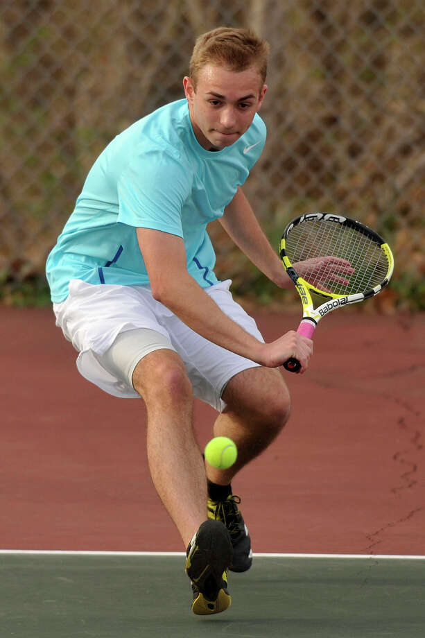 Darien's Harrison Walter returns the ball during a tennis match at Greenwich High School on Monday, April 14, 2014. Photo: Jason Rearick / Stamford Advocate