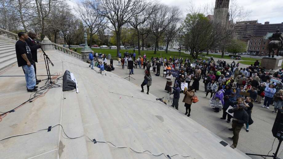 Rapper ChiliAli, left, and Five Mualimmak speak at the prison reform rally held Monday afternoon, May 5, 2014, on the steps of the Capitol in Albany, N.Y. (Skip Dickstein / Times Union) Photo: Skip Dickstein, Albany Times Union