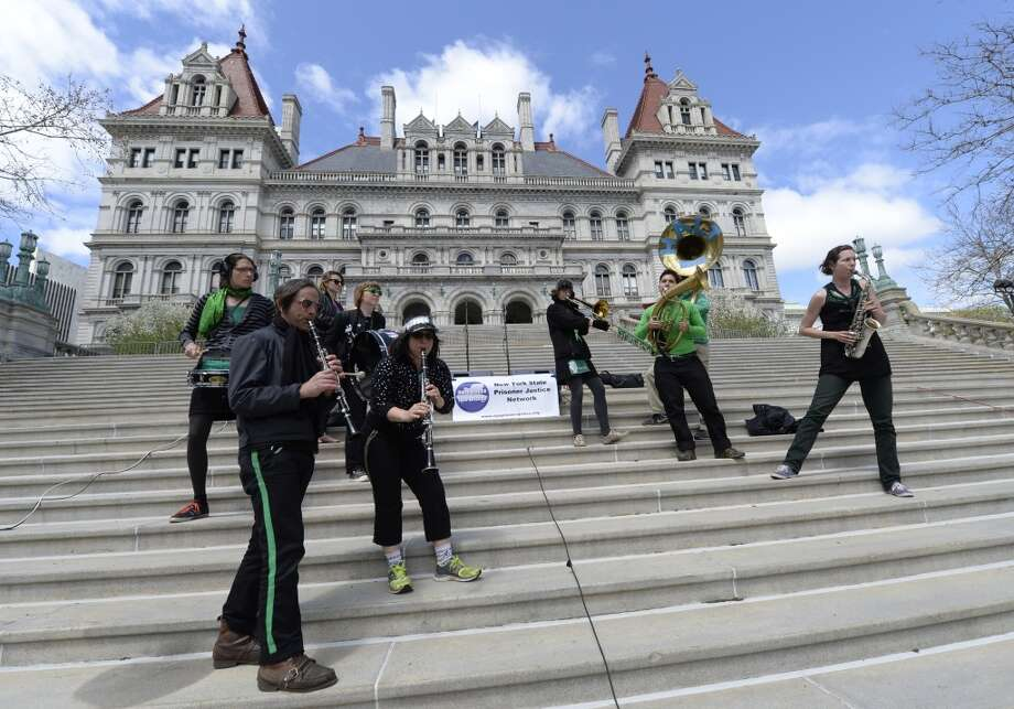 The Rude Mechanical Orchestra plays their songs in support of the prison reform rally held Monday afternoon May 5, 2014 on the steps of the Capitol in Albany, N.Y.       (Skip Dickstein / Times Union) Photo: Skip Dickstein, Albany Times Union