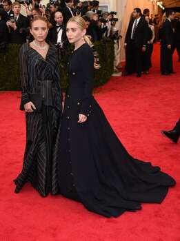 "Mary-Kate Olsen and Ashley Olsen attend the ""Charles James: Beyond Fashion"" Costume Institute Gala at the Metropolitan Museum of Art on May 5, 2014 in New York City. Photo: Larry Busacca, Getty Images"