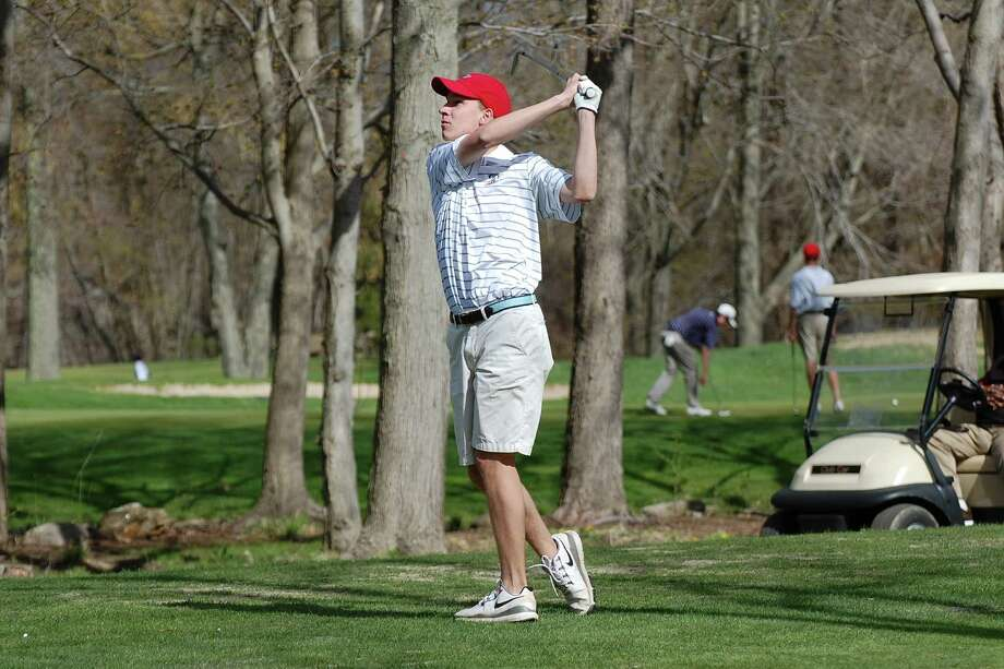 New Canaan co-captain Chris Tohir tees off against Fairfield Ludlowe at H. Smith Richardson golf course on Monday, May 5. Photo: Dave Crandall / New Canaan News freelance