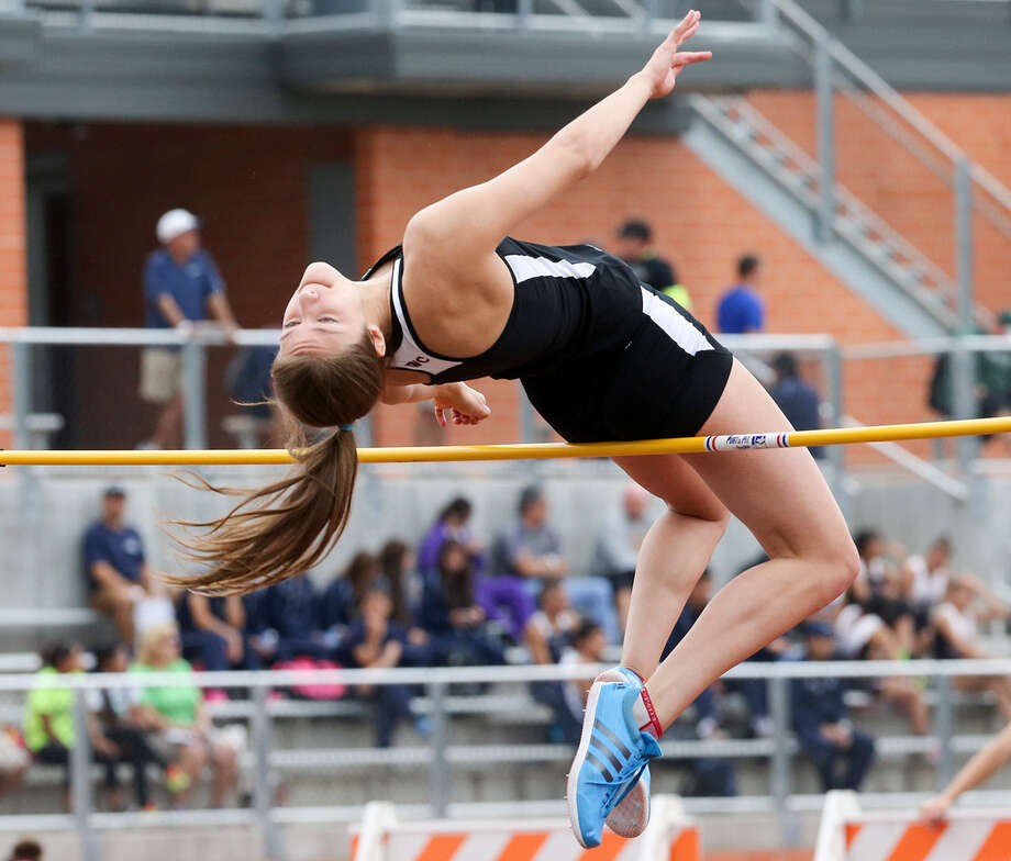 Churchill's Taylor Martinez tries to clear the high-jump bar April 25 during the Region IV-5A and Region IV-4A track and field meets. She won the event with a jump of 5 feet, 4 inches. Photo: Marvin Pfeiffer / Stone Oak Weekly / Express-News 2014