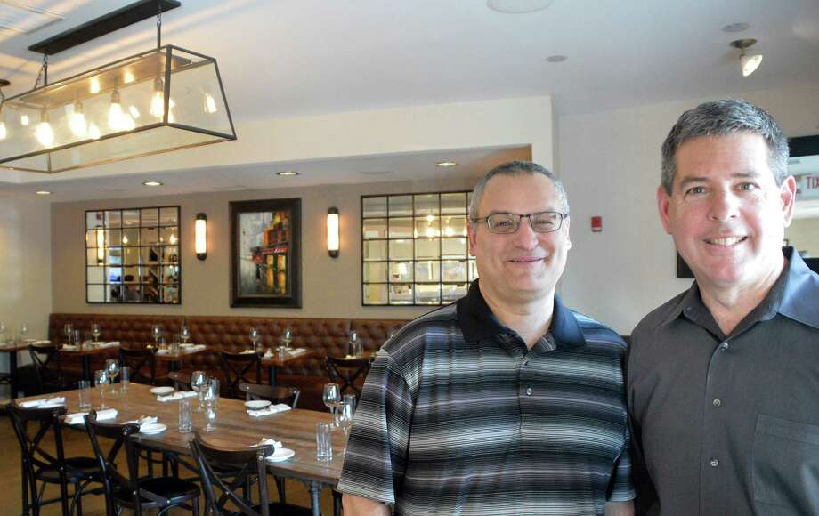 Brian Abel, left, and Steven Montello are the two principal owners of the new Bistro B at the Westport Inn. Photo: Jarret Liotta / Westport News