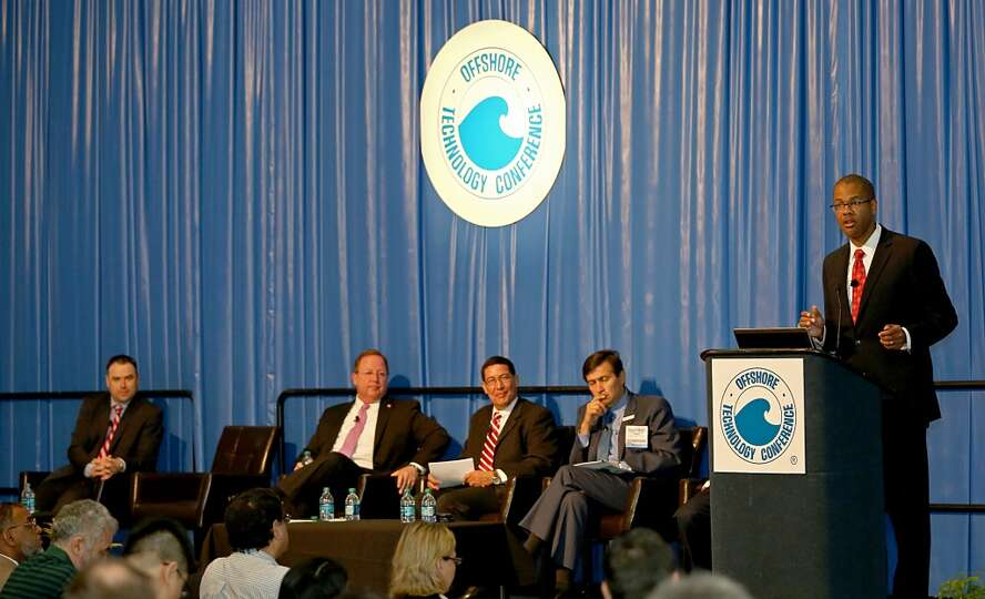 DOE's Chris Smith talks to a full house and , U.S. Rep. Bill Flores ,Pemex's Gustavo Hernandez-Garci