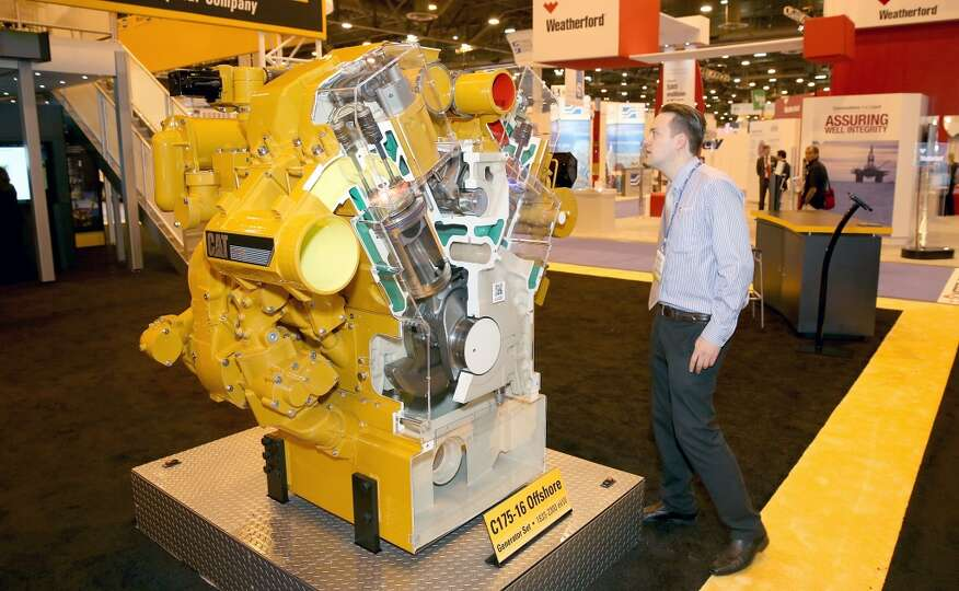 Arno Van Zyl, with OneSubsea looks at the cut out of a Caterpillar C175-16 off shore Generator Set o